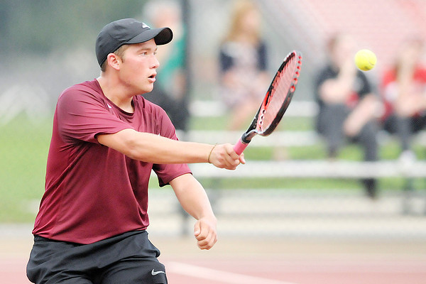 Don Knight/The Herald Bulletin<br /> Alexandria's No. 2 singles player Andy Rowe returns the ball to Anderson's Nick Whitaker druing the tennis sectional at Highland Middle School on Thursday.