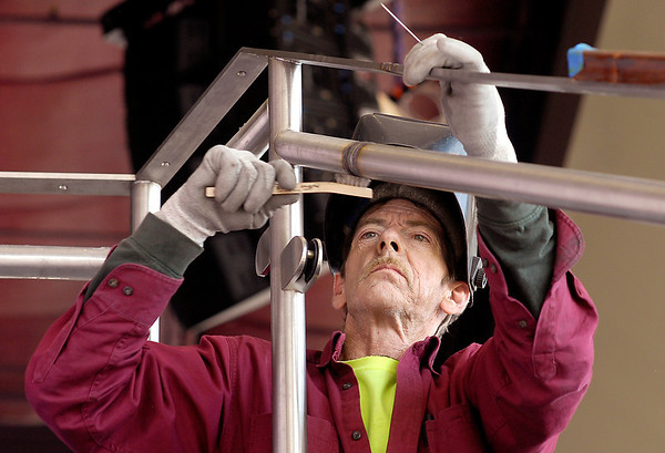 Chuck Mcintyre, a journyman fabricator for Metal Art Inc., works on metal railings at Hoosier Park Racing & Casino as part of their remodeling project.  Metal Art Inc. is planning a large expansion of their Middletown facility.