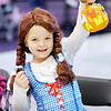 "Don Knight/The Herald Bulletin<br /> Dressed as Dorothy from ""The Wizard of Oz,"" Kenna Kane, 6, holds up her pumpkin after decorating it during the Malloween Extravaganza at Mounds Mall on Tuesday."