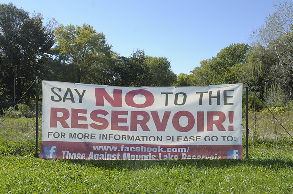 Don Knight/The Herald Bulletin<br /> Signs in the Irondale neighborhood protesting the Mounds Reservoir project.