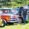 Don Knight/The Herald Bulletin<br /> Dustin Ehr from Adams County looks at the classic cars on display during the car show at the Daleville Autumnfest on Saturday.