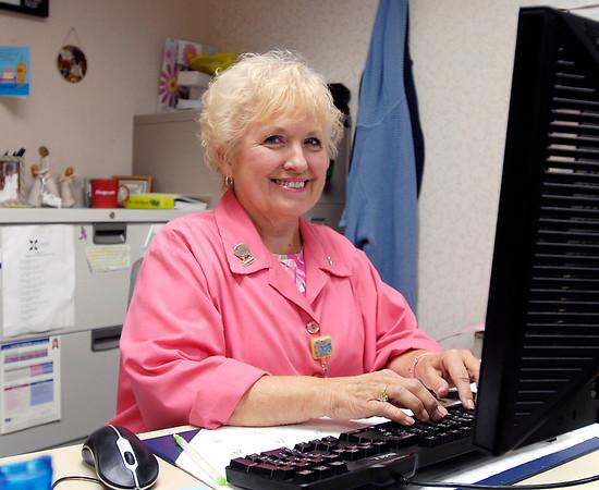Breast cancer survivor Julie Morson volunteers at St. Vincent Cancer Center.