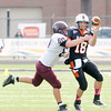 Don Knight/The Herald Bulletin<br /> Anderson quarterback Chandler Farrow passes to wide receiver Dev Thompson as he is pressured by Earlham's Kollin Wheat during homecoming on Saturday.