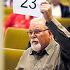 B. Scott Smith from Colorado raises his number as he bids on one of the properties that was up for tax sale Tuesday morning at the annual  Madison County Tax Sale.
