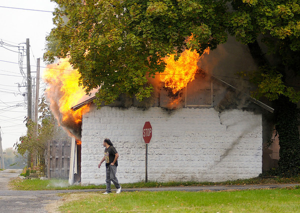 Don Knight/The Herald Bulletin<br /> A detached garage on the alley south of West 13th caught fire on Wednesday.