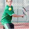 Don Knight/The Herald Bulletin<br /> Anderson's No. 1 singles player Joe Moran returns the ball to Alexandria's Mason Ward during the tennis sectional at Highland Middle School on Thursday.