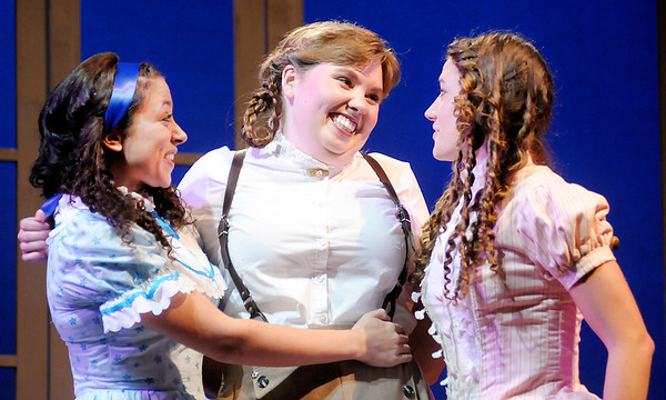 "Don Knight/The Herald Bulletin<br /> Jo March (Chelsea Leis), center, tells her sisters, from left, Beth March (Timyael Barton) and Amy March (Olivia Gnagey) about her Operatic Tragedy in The Boze Lyric Theatre's production of ""Little Women."""