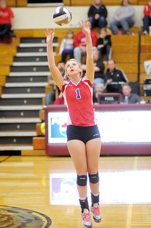 Don Knight/The Herald Bulletin<br /> Elwood's Katelyn Leisure sets the ball as the Panthers defeated Taylor 3-0 in the opening round of the Class 2A sectional at Alexandria on Tuesday.