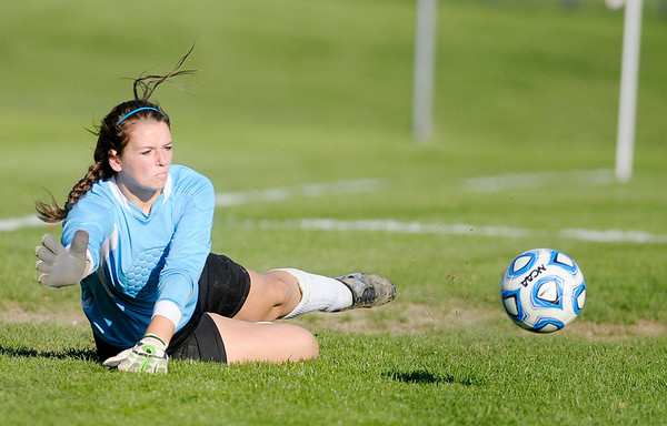 Don Knight/The Herald Bulletin<br /> Anderson goalie Clarise Clapp dives to block a shot be Pendleton Heights in the first round of the soccer sectional at Hamilton Southeastern on Thursday.