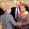 Don Knight/The Herald Bulletin<br /> Georgann Whitworth, left, greets Don and Sandy Volk at the Edge on Tuesday. The Anderson Noon Exchange Club presented the 45th Annual Book of Golden Deeds award to the Volks.