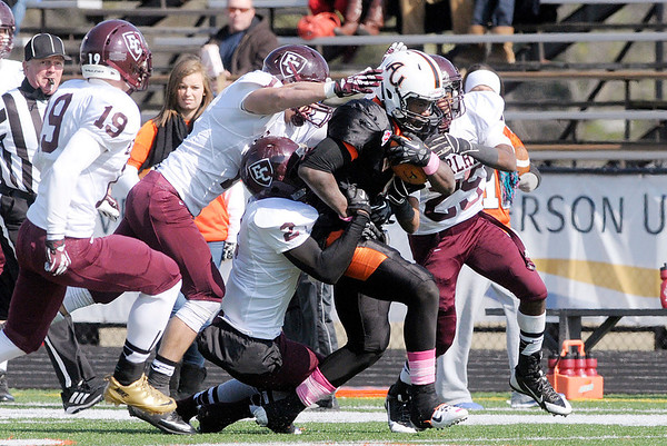 Don Knight/The Herald Bulletin<br /> Anderson Keith Thomas drags a host of Earlham tacklers during homecoming on Saturday.