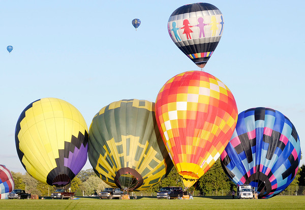 Don Knight/The Herald Bulletin<br /> Balloons take flight at the Anderson Airport during Balloons Over Killbuck on Friday. The event continues through Sunday.