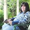 Don Knight | The Herald Bulletin<br /> Breast cancer survivor Lisa Morgan enjoys reading.