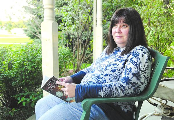 Don Knight   The Herald Bulletin<br /> Breast cancer survivor Lisa Morgan enjoys reading.