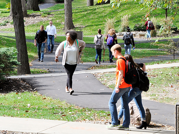 John P. Cleary | The Herald Bulletin<br /> Students walk through the valley on the Anderson University campus as they move between classes Tuesday afternoon.