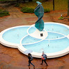 Don Knight | The Herald Bulletin<br /> Students walk past the Helios sculpture as steady rain fell Thursday afternoon. Temperatures are only forecast to get into the 50s today.