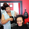 Don Knight | The Herald Bulletin<br /> Nikhea Jackson styles the hair of her sister Denise Bradley at Re-defined Salon. The Salon, 1310 S. Meridian St., held its grand opening on Sept. 30th.