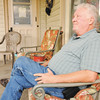 Don Knight | The Herald Bulletin<br /> Tim Montgomery sits on the porch at Stepping Stones in Anderson where he lives.