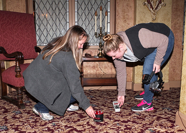 Mark Maynard | For The Herald Bulletin<br /> Stephanie Vorhees and Lauren Keesling of Indiana Ghost O.P.S. set-up paranormal activity detection instruments in preparation for their investigation while spending a night at the Paramount.
