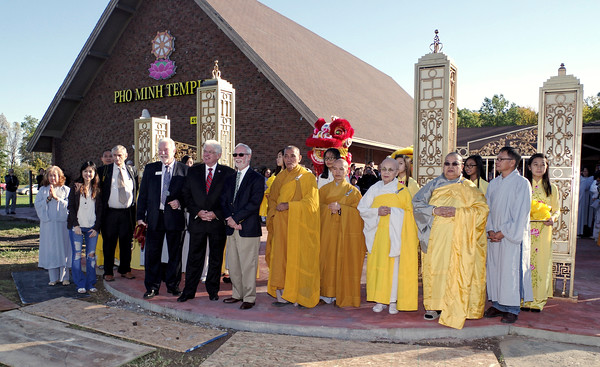 Mark Maynard   For The Herald Bulletin Gerry Longenbaugh of the Madison County Chamber of Commerce, Anderson Mayor Thomas Broderick, Jr. and State Senator Tim Lanane joined Buddhist church officials for the opening of the new Pho Minh Temple on Sunday.
