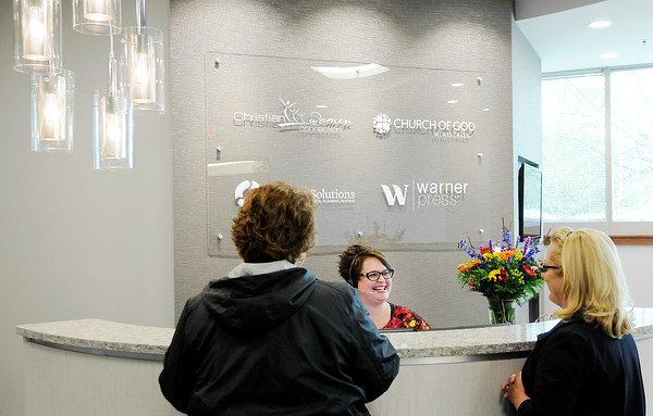 Don Knight   The Herald Bulletin<br /> Receptionist Charity Harvey greets visitors to Church of God open house at their new location in Flagship on Tuesday. The church has leased just over half the 70,000 square foot building.