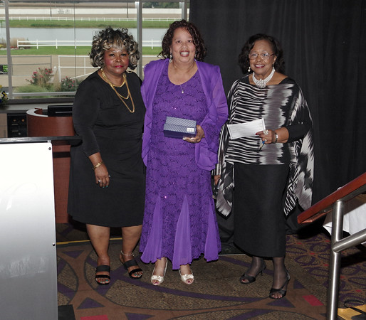 Presenter Christy Jones (left) and Mistress of Ceremonies Betty Williams (right) with Anderson /Madison County Black Chamber of Commerce Cameron/Fenner Educational Award winner Jean Ann Johnson.