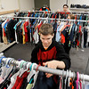 John P. Cleary | The Herald Bulletin<br /> AHS's D26 Career Campus employment skills class students Caleb Ground, foreground, Tiana Marsh and Preston Cox sort clothes in Jacara's Closet at the school that will open this week.