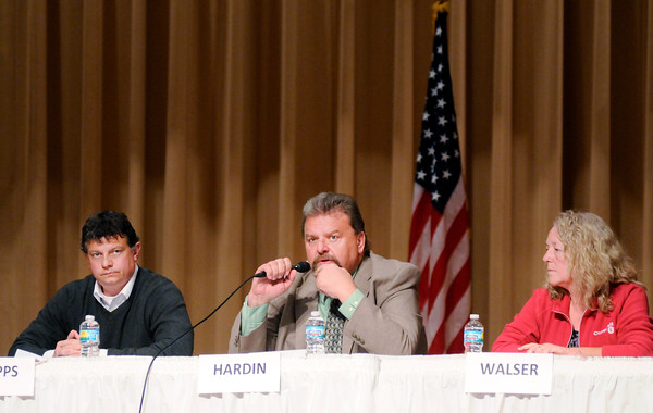 Don Knight | The Herald Bulletin<br /> County Commissioner Middle District Democratic incumbent Jeff Hardin, center, answers a question as Republican Mike Phipps and Libertarian Tracey Walser wait their turn during a forum County Commissioners and County Council at the city building on Wednesday.