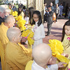 Mark Maynard | For The Herald Bulletin<br /> Local dignitaries and church officials share the ribbon cutting duties during the opening of the Pho Minh Buddist Temple, located at 4100 South Main Street in Anderson, on Sunday morning.