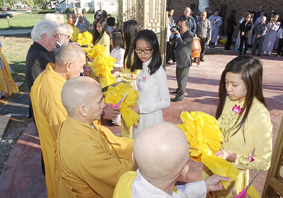 Mark Maynard   For The Herald Bulletin Local dignitaries and church officials share the ribbon cutting duties during the opening of the Pho Minh Buddist Temple, located at 4100 South Main Street in Anderson, on Sunday morning.