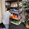 John P. Cleary | The Herald Bulletin<br /> AHS's D26 Career Campus employment skills class student Shawn Parkhurst stocks the school supplies area of Jacara's Closet.