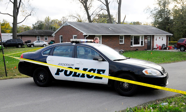 Don Knight   The Herald Bulletin<br /> APD investigates a shooting in the 1800 block of West 21st Street on Thursday.