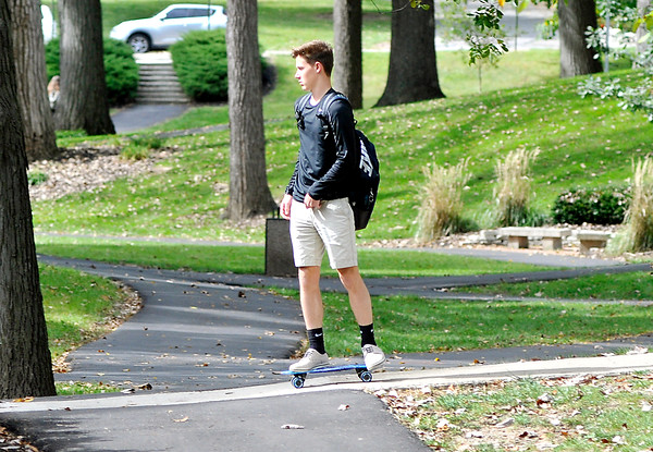 John P. Cleary | The Herald Bulletin<br /> Daniel Collins, an AU freshman from Lebanon, takes advantage of the sloping walkway through the valley to ride his skateboard and save some energy as he works his way across campus.