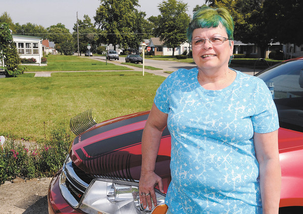 Don Knight   The Herald Bulletin<br /> Breast cancer survivor Loretta Brown is happy being her own self from her blue hair to the eyelashes on her Dodge she calls Ms. Cherry.