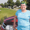 Don Knight | The Herald Bulletin<br /> Breast cancer survivor Loretta Brown is happy being her own self from her blue hair to the eyelashes on her Dodge she calls Ms. Cherry.