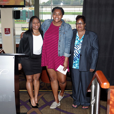Anderson/Madison County Black Chamber of Commerce Board Chair Award recipients Raniqua Davis (left) and Myrna Ivy (right) present a scholarship to Ma'Quanna Rush during the Chamber's Annual Banquet.