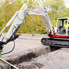 Don Knight | The Herald Bulletin<br /> A crew from Shannon Excavating jack hammers through pavement on the east end of the bridge over Killbuck Creek on Cross Street on Wednesday. Cross street will be closed through November 7th so the bridge beams can be repaired.