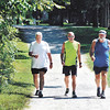 John P. Cleary | The Herald Bulletin   POH series<br /> Senior citizen Stephen Hedgecraft, left, works out with friends Steve Dearing and Greg Smith at Mounds State Park as they head out for a 5-mile walk over the trails of the park.