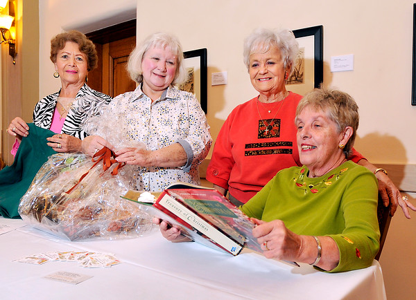 """John P. Cleary   The Herald Bulletin<br /> Anderson Center for the Arts Women's League members Mary Swango, Debbie Long, Jan Scott, and Chris Bell go over details for their """"Fall into The Holidays"""" Boutique & Box Luncheon being held Wednesday, Oct. 19th."""