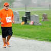 Don Knight | The Herald Bulletin<br /> Heavy rain doesn't deter a runner in Lapel's Zombie 5K Walk/Run on Saturday. The event was hosted by the Lapel Parks and Recreation Department to raise funds for the town's parks.