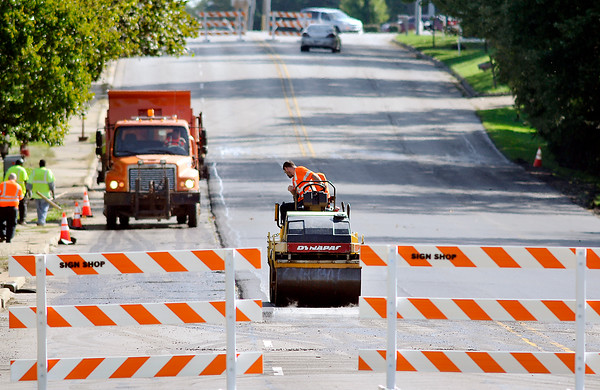 John P. Cleary   The Herald Bulletin<br /> A busy stretch of East 38th Street was closed Tuesday morning for the city to repave a bad section of roadway in the 1900 & 2000 block. The road was smoothed over and reopened by mid-afternoon.