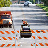 John P. Cleary | The Herald Bulletin<br /> A busy stretch of East 38th Street was closed Tuesday morning for the city to repave a bad section of roadway in the 1900 & 2000 block. The road was smoothed over and reopened by mid-afternoon.