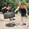 Don Knight | The Herald Bulletin<br /> Shirley Payne spins her son Alex in a tire swing during a visit Mounds State Park in July.