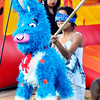 John P. Cleary |  The Herald Bulletin<br /> Jennifer Castro, 11, take a swing at a pinata during the Hispanic Heritage Fiesta hosted by Madison County Community Health Center Saturday.
