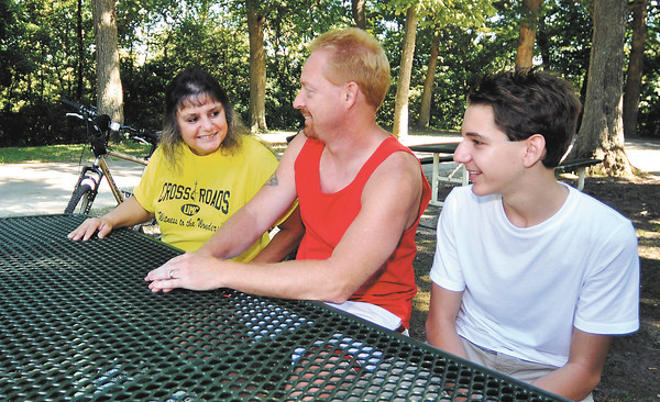 John P. Cleary | The Herald Bulletin    POH-part 5<br /> Melinda Pierce, with her husband Mike and son Xavier, 13, take a break from riding their bikes at Shadyside Park.