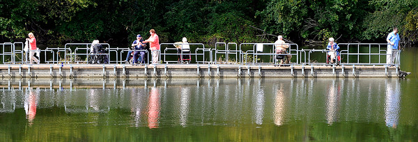 John P. Cleary | The Herald Bulletin<br /> Bethany Pointe residents and staff take in some fishing along the pier during an outing at Shadyside Lake Monday afternoon.