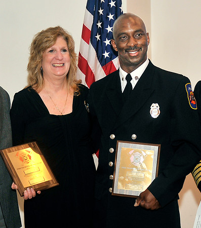 John P. Cleary | The Herald Bulletin<br /> Debbie Condon and Sherman Carter with their awards presented to them by the Anderson Noon Exchange Club Tuesday. Condon's late husband John F. Condon, a highly decorated AFD battalion chief, was honored by the service club as well as Carter, a sergeant with Anderson Fire Department, who was named Firefighter of the Year.