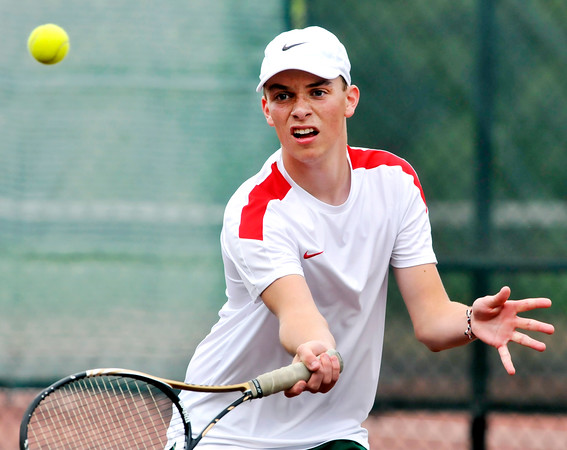 John P. Cleary | The Herald Bulletin<br /> Anderson's #3 singles player Austin Mote flips a forehand over the net during his sectional match against AHS. Mote won his match 2-0.