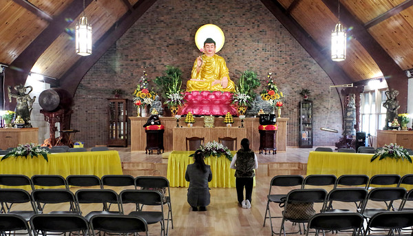 Mark Maynard   For The Herald Bulletin Two Buddhist congregants worship in the new Pho Minh Temple which opened on Sunday at 4100 South Main Street.