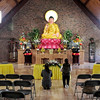 Mark Maynard | For The Herald Bulletin<br /> Two Buddhist congregants worship in the new Pho Minh Temple which opened on Sunday at 4100 South Main Street.
